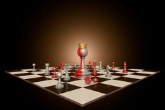 The successful personality. Chess pieces on a dark background art. In the center of a huge two-tone frame a pawn with a crown Royalty Free Stock Photos