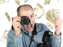 Successful photographer. A successful microstock or stock photographer, showered with the money he has earned from his craft.  A winner Royalty Free Stock Photos