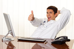 Successful physician sits at a desk Royalty Free Stock Image