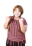 Successful plump woman punching the air with her fists in air, s Stock Photos