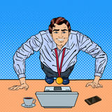 Successful Pop Art Business Man with Medal Doing Push-ups on the Office Table with Laptop Stock Photo
