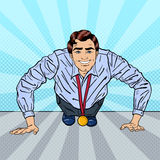 Successful Pop Art Business Man with Medal Doing Push-ups Stock Images