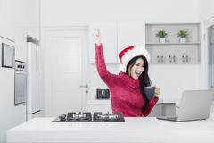 Successful pretty girl with laptop and Santa hat Royalty Free Stock Photo
