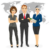Successful professional business team standing with arms folded in front of an earth map Stock Images