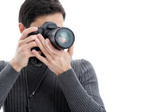 Successful professional photographer use DSLR digital camera iso. Young successful professional photographer in shirt use DSLR digital camera isolated on white Royalty Free Stock Photo