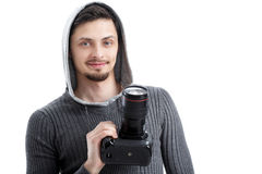 Successful professional photographer use DSLR digital camera iso. Young successful professional photographer in shirt use DSLR digital camera isolated on white Royalty Free Stock Image