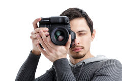 Successful professional photographer use DSLR digital camera iso. Young successful professional photographer in shirt use DSLR digital camera isolated on white Stock Image