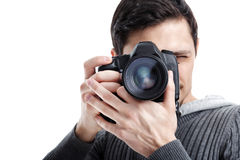 Successful professional photographer use DSLR digital camera iso. Young successful professional photographer in shirt use DSLR digital camera isolated on white Stock Photography
