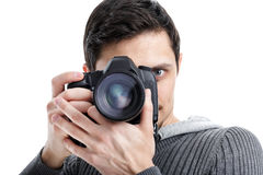 Successful professional photographer use DSLR digital camera iso. Young successful professional photographer in shirt use DSLR digital camera isolated on white Royalty Free Stock Images
