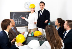 Successful professionals with laptops and helmets Royalty Free Stock Photo