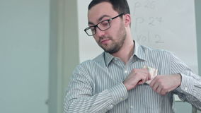 Successful professor making money, counting dollars. Close up. Professional shot in 4K resolution. 075. You can use it e.g. in your commercial video, business stock footage