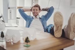 Joyful positive man smiling stock photography