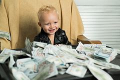 Successful project. Little entrepreneur work in office. Startup business costs. Boy child with money case. Little boy. Count money in cash. Small child do royalty free stock photography