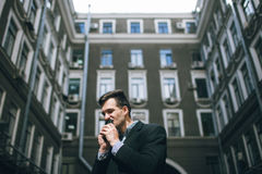 Successful promotion. Happy businessman with phone Royalty Free Stock Photo