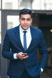 Successful rich businessman outdoors. Handsome businesslike man in suit. Careerist and workaholic Stock Photography