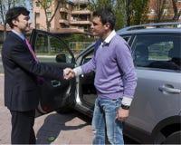 Successful Sale with Handshake. Handshake between customer and car salesperson Stock Photo
