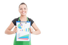 Successful sales woman holding clipboard with financial charts Royalty Free Stock Image