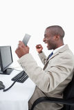 A successful salesman holding a phone handset Stock Photo