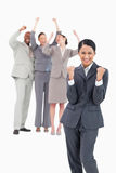 Successful saleswoman with cheering team behind her Stock Image