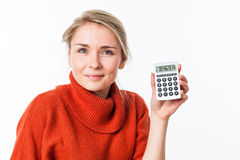 Successful savings for peaceful young blond woman smiling Stock Photography