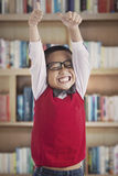 Successful schoolboy in library Stock Photo