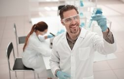Successful scientist checking the results of the examination. stock photos