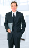 Successful Senior Businessman Holding Book Royalty Free Stock Images