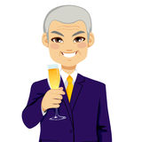 Successful Senior Businessman Toasting Champagne Stock Photo