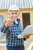 Successful senior citizen as craftsman. Holding thumbs up stock images