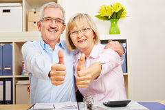 Successful senior couple holding thumbs up Stock Photos