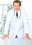 Successful Senior Doctor Standing By Table Royalty Free Stock Photos