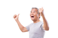 Successful senior man looking up with thumb up gesture Royalty Free Stock Images