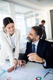 Successful team leader and business owner leading informal in-house business meeting royalty free stock images