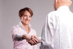 Successful senior woman handshaking royalty free stock photography