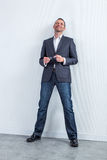 Successful serene handsome 40s businessman for modern corporate portrait Stock Photo