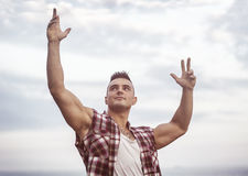 Successful sexy muscular man with hands raised Royalty Free Stock Photo