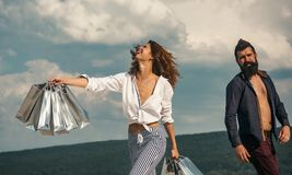 Successful shopping. sense of freedom. couple in love. present packages. family holiday. summer fashion. spring. bearded. Men with happy women hold shopping bag royalty free stock image