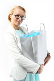Successful shopping - woman with a bag of purchasing. Royalty Free Stock Photo