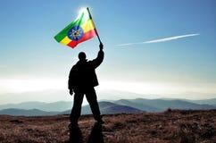 Successful silhouette man winner waving Ethiopian flag Stock Photo