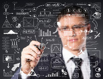 Successful and smart businessman writing diagrams. Businessman working with a business plan. Financial, currency, technology and money concept Stock Images