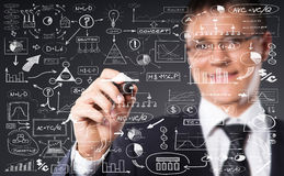 Successful and smart businessman writing imaginary text. Businessman working with a business plan. Financial, currency, technology and money concept Stock Image