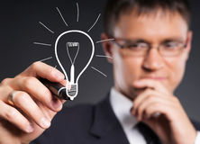 Successful and smart businessman writing with a marker Stock Photography