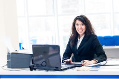 Successful smiling woman at office with pc screen Stock Image