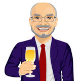 Successful smiling senior businessman toasting with a glass of champagne Stock Photography