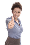 Successful smiling young business woman with thumbs up Stock Photo