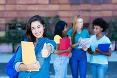Successful spanish female student with group of students royalty free stock images
