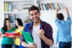 Successful spanish male student with group of students royalty free stock photos