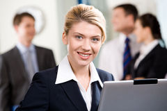 Successful specialist. Portrait of successful specialist with wonderful smile in a office environment stock image