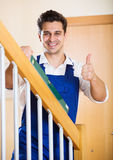 Successful specialist building stairway in new house Royalty Free Stock Images