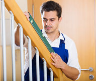 Successful specialist building stairway in new house Royalty Free Stock Photography